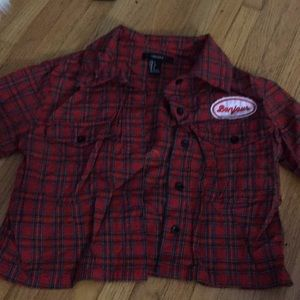 A cropped flannel with a bonjour patch on it